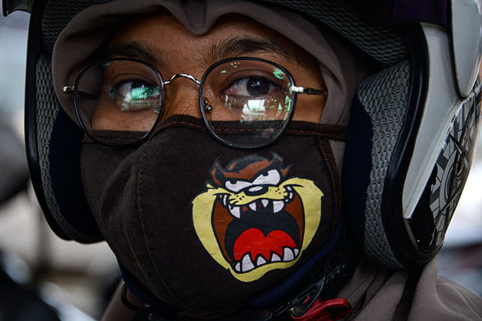 woman wears a face mask amid concerns over the 19 coronavirus in anda ceh on arch 27 2020 hoto by