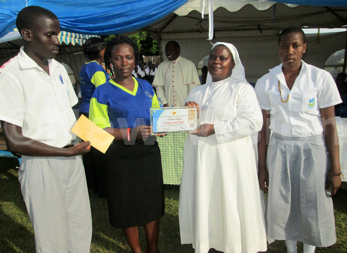 aint arys  kozi students and their head teacher ister sanyu pose for a photo with their certificate after being declared as the best participants in rolife ovement