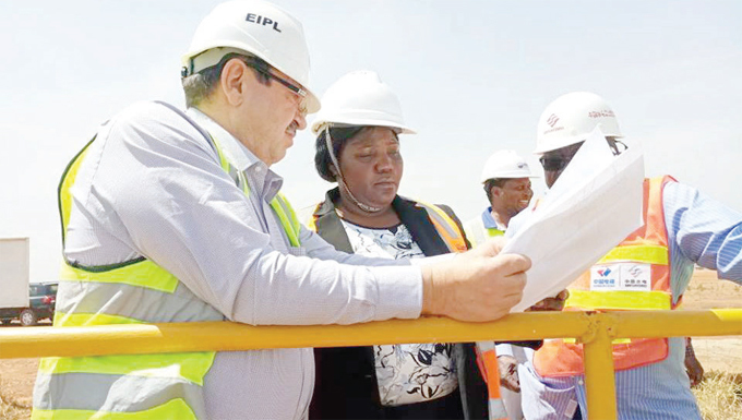 aako centre is joined by staff and contractors at one of the construction sites he authority emerged best in frica