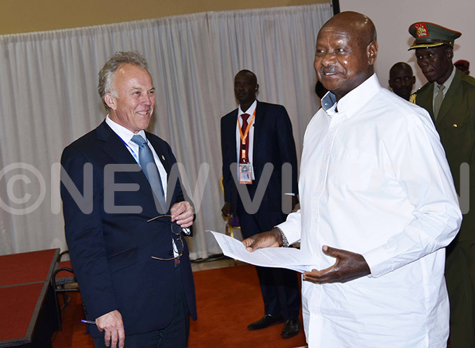 ichael eating the pecial epresentative of the ecretaryeneral for omalia and ead of the nited ations ssistance ission in omalia  interacts with resident oweri useveni  during the ummit