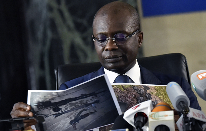 vorian tate prosecutor ichard dou shows pictures of seized weapons during a press conference at bidjans courthouse in bidjan on ecember 26 2019  vory oast prosecutors on ecember 23 2019 issued an arrest warrant for presidential candidate uillaume oro who aborted a planned return by diverting his flight to hana as security forces stormed his party headquarters in bidjan he tate prosecutor clarified on ecember 26 the charges against oro saying he was preparing a civil and military insurrection to soon seize power accusations swept aside by the defense hoto by