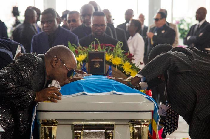 mourner kisses the coffin of rumba musician apa emba during his funeral in inshasa on ay 2 2016 emocratic epublic of ongos rumba king apa emba was posthumously awarded one of his countrys highest honours a week after he collapsed on stage and died aged 66