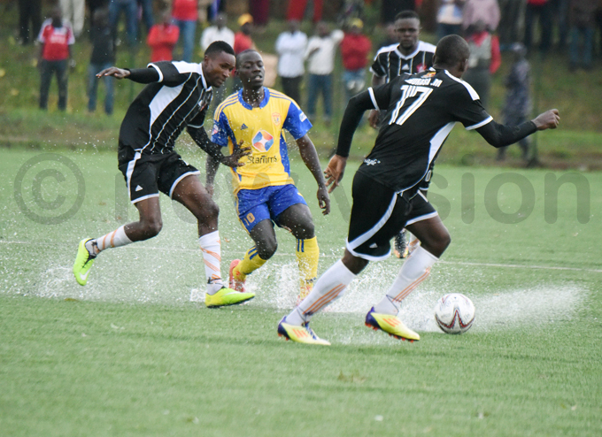 he game was played in wet conditions following a heavy afternoon downpour hoto by palanyi sentongo