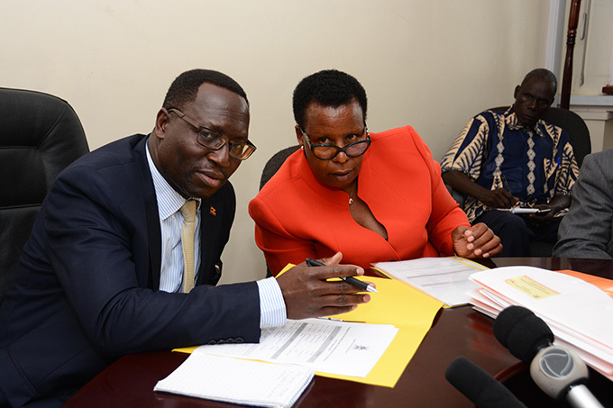 he undersecretary of the ministry of education ggrey ibenge left listens to assistant commissioner technical education oy uhwezi during the signing ceremony of memorandum of understanding at the ministry headquarters in ampala