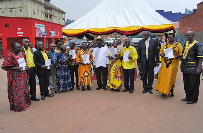 resident useveni with some of the people who received their land titles hoto by ob amanya