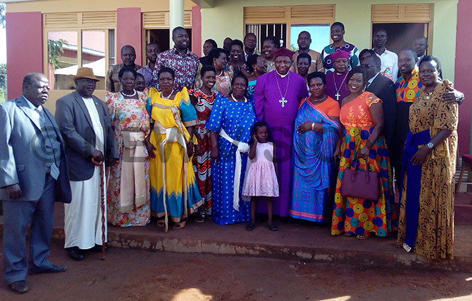 rchbishop tanley tagali poses for a photo with isu family at awojani abwangasi in utebo district hoto by awrence kwakol
