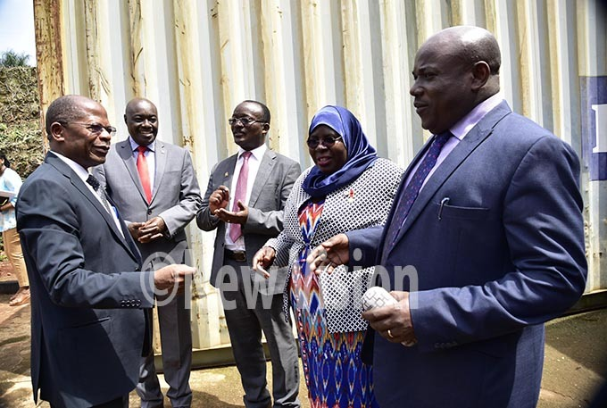 tate minister for higher education ohn  uyingo  ashari south and irector akerere usiness nstitute  athan tungo  board chairman ilver ugisha ommissioner  ajjat afinah usene and  executive secretary nesmus yesigye interact on arrival of the minster uyingo shortly before the release of   2019 examinations results at the  offices in tinda  10 2019