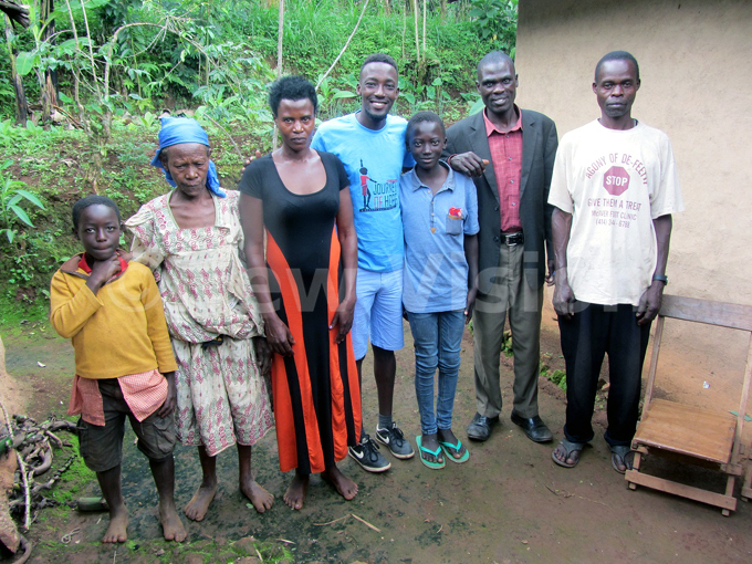 hisa in blue tshirt and slippers being resettled with family in ududa