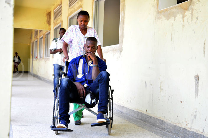 hotojournalist ndrew wanga seated on a heelchair during his admission at ampala ospital ololo on 09022016 hoto by ajarah alwadda