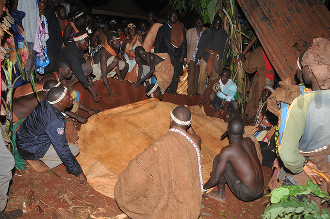 embers of the aswezi community performing rituals after laying abamba udhagali to rest at his home in inja hoto by onald iirya
