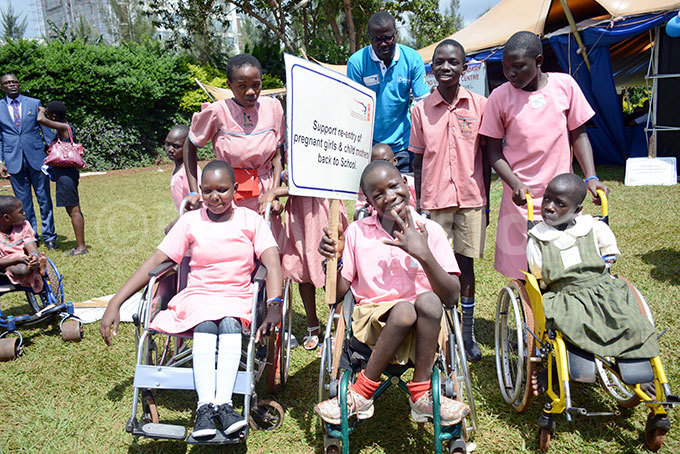upils from ampala chool of the handicapped during the orld hildrens ay celebrations by  and and other hild ights s in ganda at the even rees ardens in ololo hoto by iriam amutebi