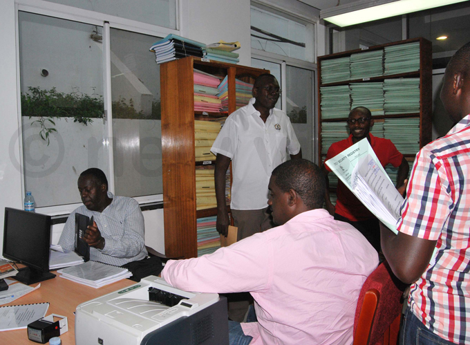 umusiime and his team submitting their reply to the petition at the registrars office hoto by odiver sege