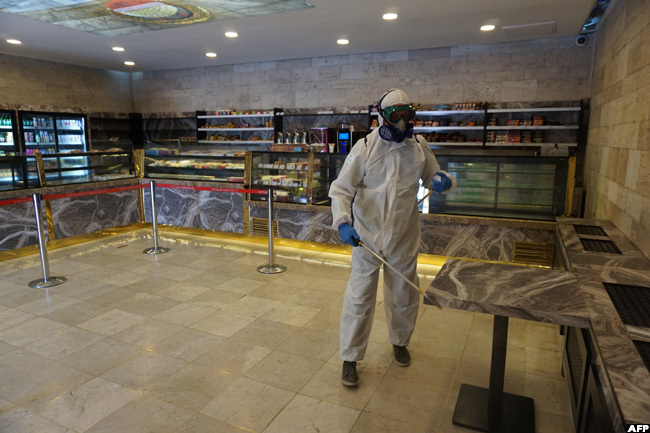 city employee is at work to disinfect a store at nitkabir the mausoleum of the founder of the urkish epublic ustafa emal taturk in nkara