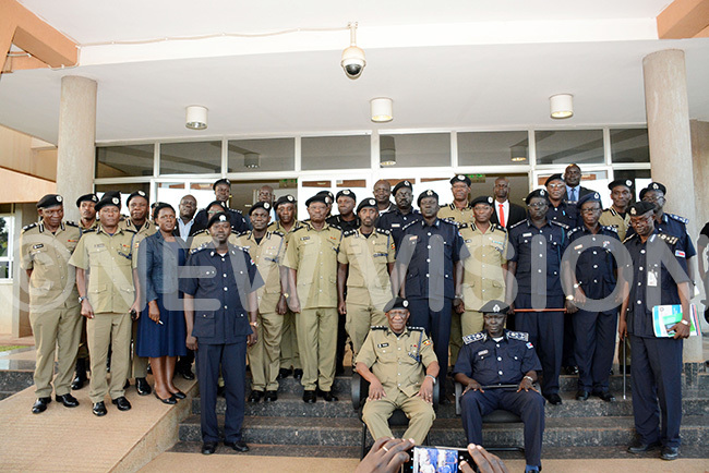 he nspector eneral of olice artin kothchola with his counterpart from outh udan en ajok kec alok both seated pose for a group photo with senior police officers from both countries at ganda olice headquarters in aguru where officers from the two countries started bilateral talks related to security and crossborder crime