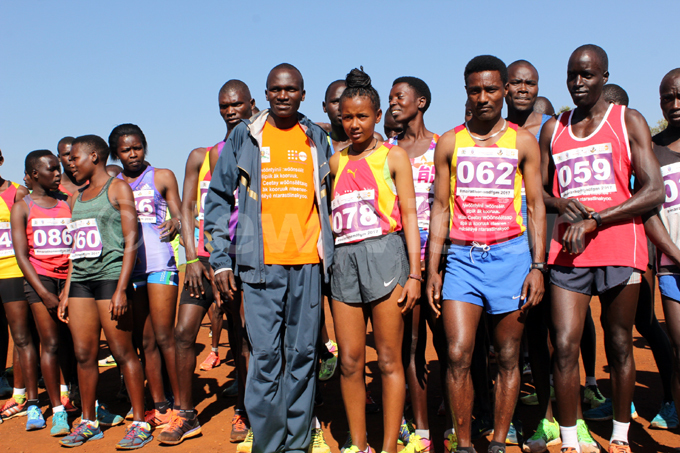 tephen iprotich range tshirt with some of the marathon runners in apchorwa