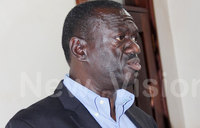 We are wasting time, says Besigye at court