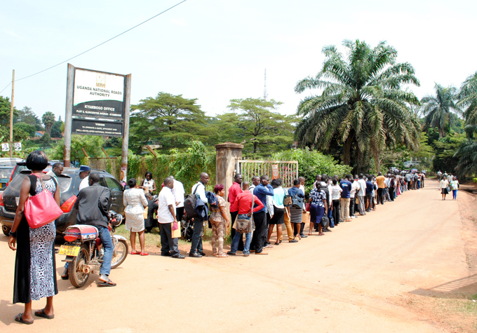 pplicants formed lengthy cues to submit their applications letters at s yambogo offices in anuary hoto by ajarah alwadda