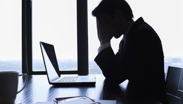 depressionbusinessmanthinkinglosssadoverworked100613849orig