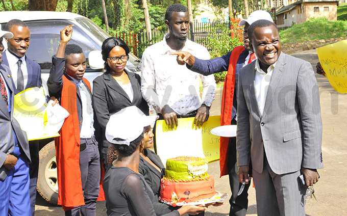 tudents last week presented a cake to amunyu left who is under suspension hoto by ilfred anya