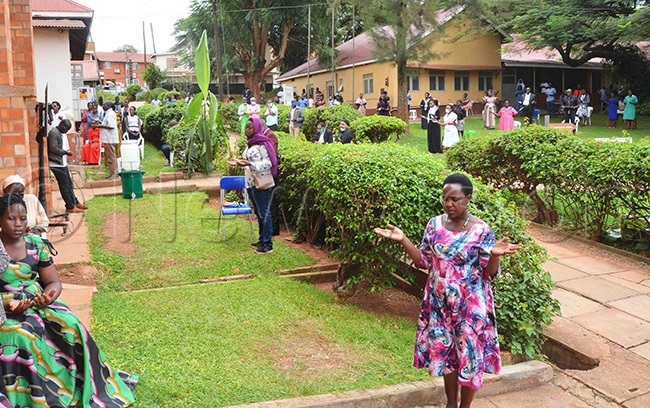 cattered members of sambya ospital ommunity following r dumbas funeral mass on screens