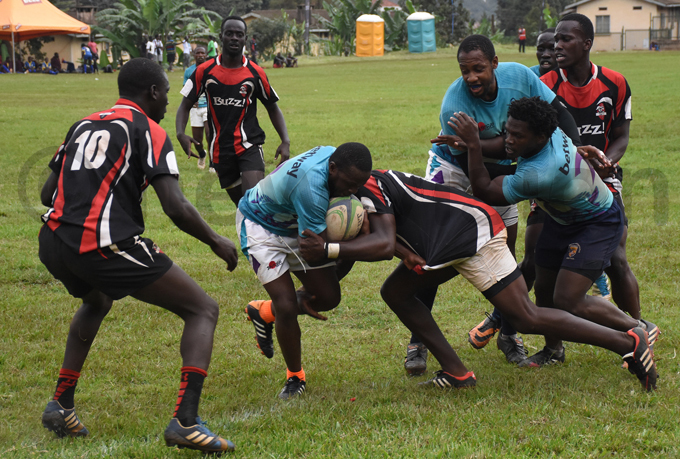 irates players tackle obs avis iwalabye during one of the games hoto by ohnson ere