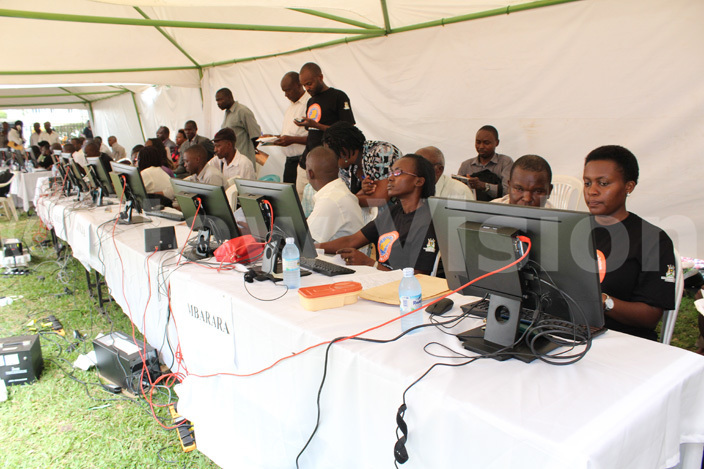 inistry of lands staff handle clients complaints at the help desk during the pen ay