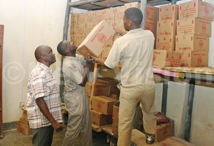 emwogerere supervising workers at the factoryhotos by dward isoma