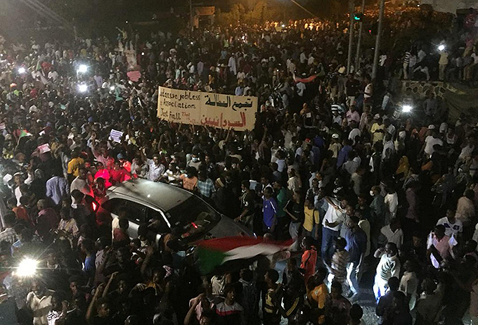 udanese demonstrators chant slogans as they gather at night during a demonstration in front of the military headquarters in the capital hartoum  hoto