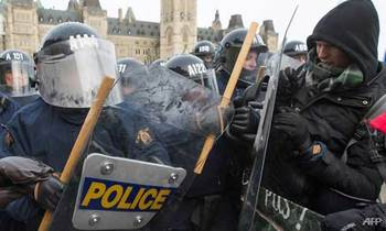 Counter protesters clashed with police during the far right rally against the un international pact on migration 1544304158140 2 350x210