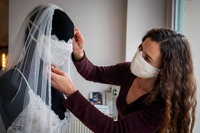 edding dress and evening wear designer riederike orzig adjusts a mannequin wearing a wedding dress with matching protective mask in her store hiton in erlin on arch 31 2020 as the ermany continue to battle the ovid19 corona virus pandemic  s all weddings and events have been cancelled the erman fashion designer are creating fashionable facemasks in her workshop selling them in her shop in erlins choeneberg district hoto by dd