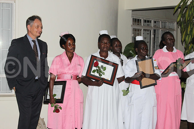 idwives pose for a picture with  representative lain ibenaler