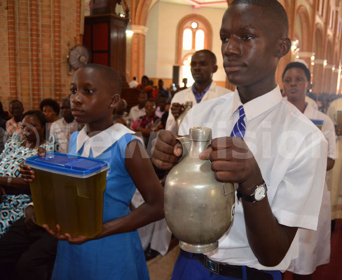 hildren carrying the oil of the atechumens during the hrism mass at ubaga athedral on oly hursday