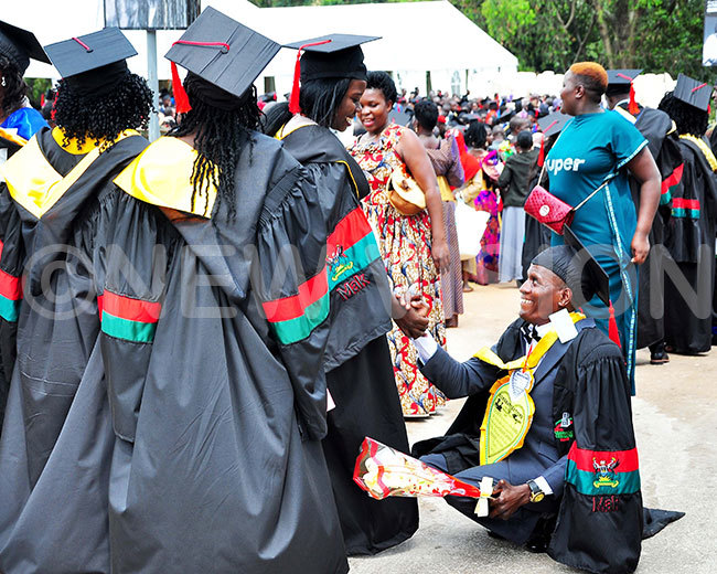 isability is not inability bu enywa interacts with his colleagues during the 69th graduation ceremony