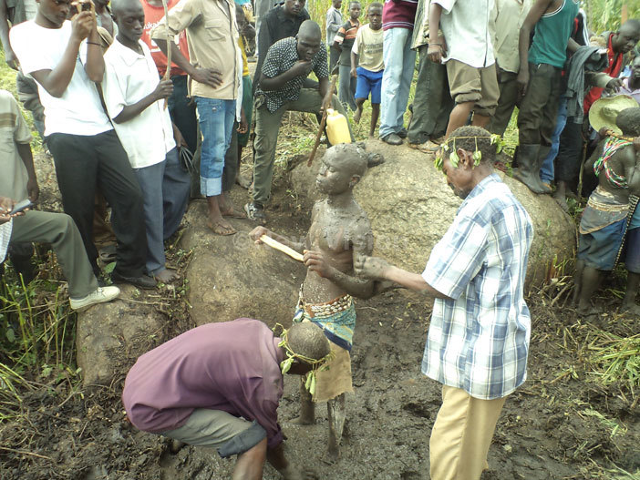 candidate is smeared with ud from a swamp near utotohe muddy swamp is strongly associated with the ancestral diety of mbalu or the umusambwa wembalu