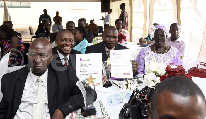 ric asereka 2nd left shows off his certificate