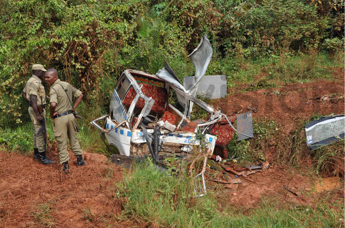 olice officers observe the wreckage of the taxi hoto by addy ukenya