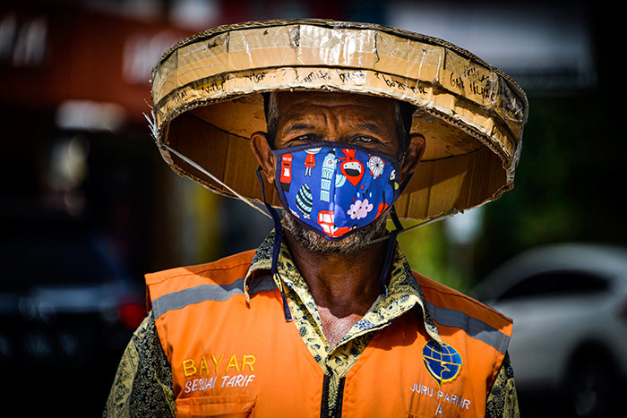 man wearing a face mask amid concerns of the 19 coronavirus walks on a street in anda ceh on arch 28 2020 hoto by