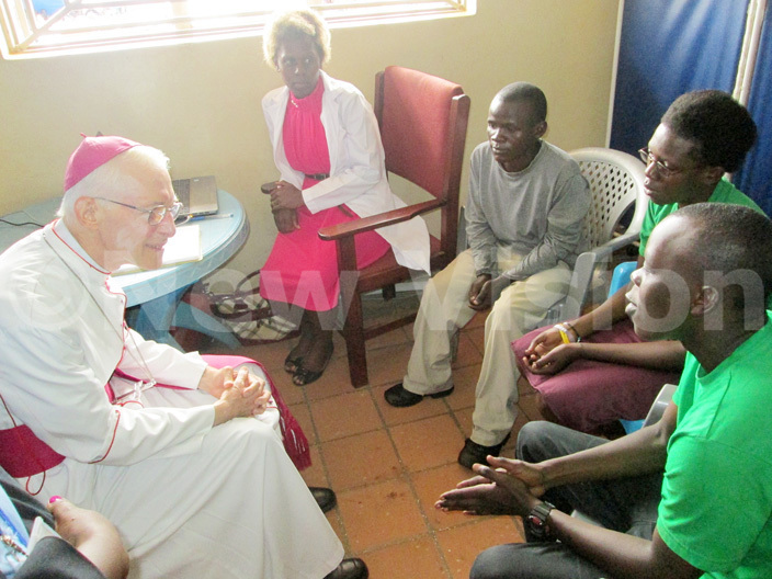 rchbishop lume listens to a testimony by one of the clients of each ut buya