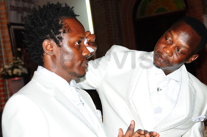 est man esach emakula wiping ildermans tears of joy during the ceremony at ubaga athedral