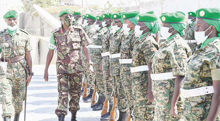 Maj. Gen. Owinow inspecting a parade mounted by Ugandan soldiers serving under AMISOM during the medal parade