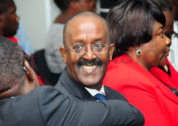 lectoral ommission ecretary eneral am wakoojo smiles after the court ruling hoto by icholas neal