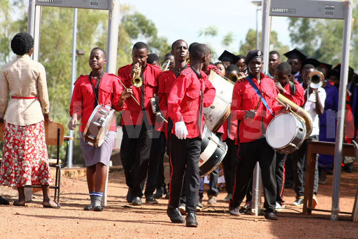 he band leads delegates to the graduation ground