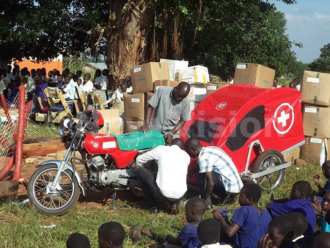 village health trainer is shown how to assemble a community ambulance
