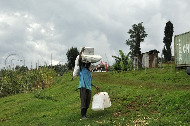 ne of the survivors carrying some of the relief nonfood items from ganda ed ross ociety in ulambuli