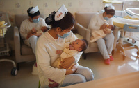 Born again: baby boom after China ends one-child rule