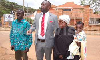 Faridah kiconco with her lawyer amon kategaya m and her husband after the meeting 350x210