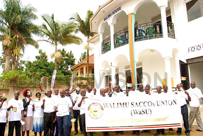 eachers under their sacco  s nion matching within the compound of their new building in iwatule hoto by gnes antambi