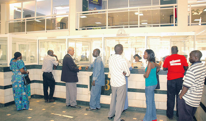 eople in a banking hall he nsurance egulatory uthority has licensed 14 banks to operate as bancassurance agents