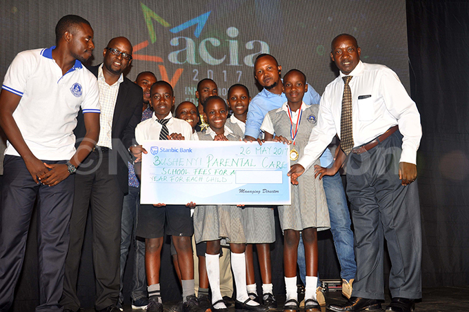 inners young  innovators awards ushenyi arental are rimary chool display a chaque for schools fees during  awards gala at ampala erena otel on riday ay 26 2017ccording to  management each of the nine pupils are to receive scholarships for one year hoto by rancis morut