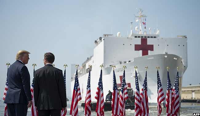 resident rump and efense ecretary ark sper watched as the hospital ship  omfort departed aval ase orfolk in orfolk irginia for ew ork ity to aid in the coronavirus outbreak